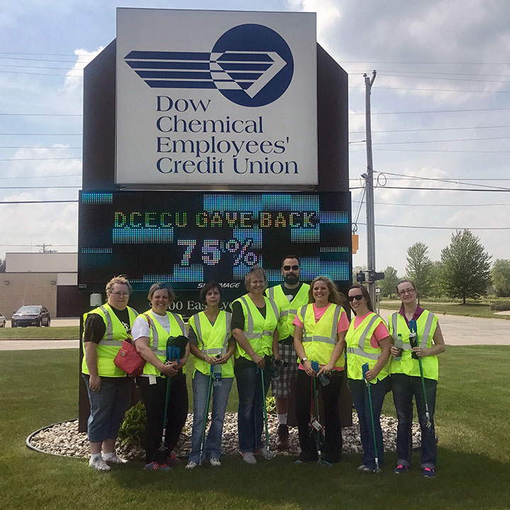 Volunteers pose for group photo during roadside cleanup