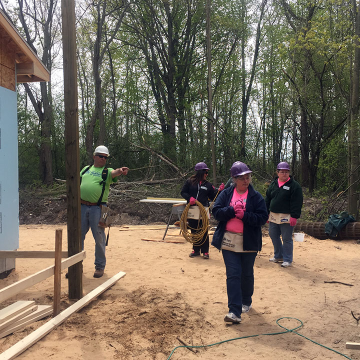 Volunteers working on Habitat for Humanity worksite